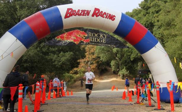 Mike Sohaskey crossing finish line at Rocky Ridge Half Marathon