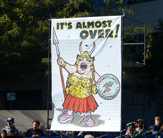 """It's Almost Over"" sign near finish of Portland Marathon 2013"