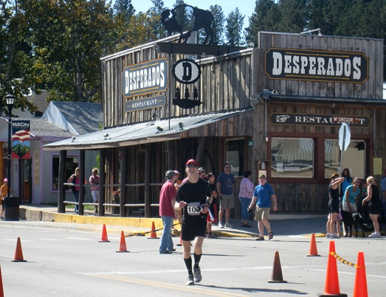 Mike Sohaskey approaching finish of Run Crazy Horse Marathon 2011