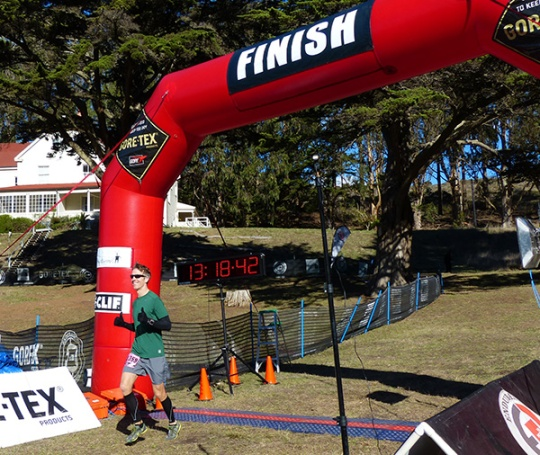 Mike Sohaskey crossing finish line of 2013 The North Face Endurance Challenge Championship marathon