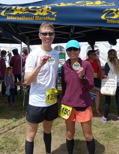 Mike Sohaskey and Jen with Big Sur International Marathon finisher's medallions
