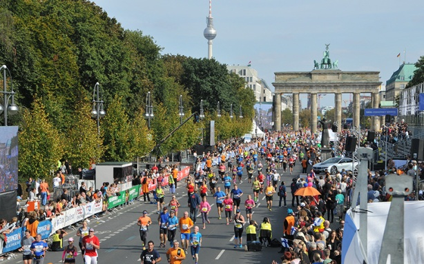Berlin Marathon - runners finishing through Brandenburg Gate