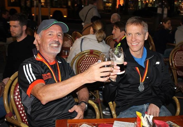 Mike Sohaskey and Herzel celebrating Berlin Marathon finish