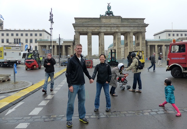 Mike Sohaskey & Katie Ho straddling boundary of former Berlin Wall
