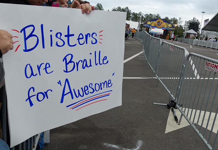 Blisters spectator sign at Walt Disney World Marathon