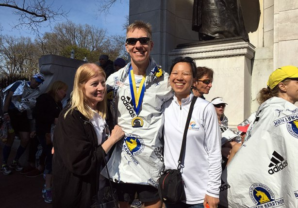 Boston Marathon finish line family hug