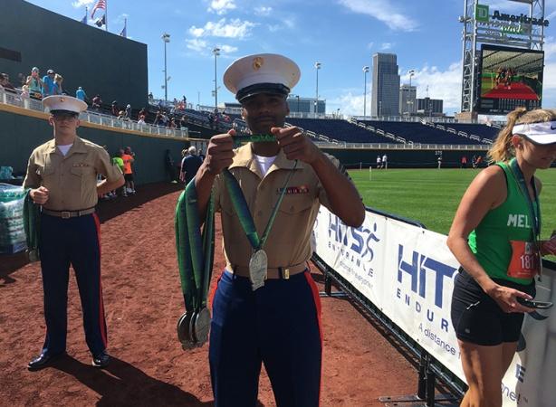 U.S. Marine awarding Omaha Marathon medal