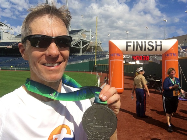 Mike Sohaskey with Omaha Marathon medal