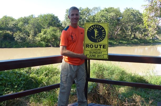 Mike Sohaskey with Comrades Marathon course sign