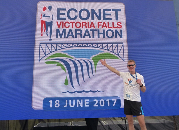 Mike Sohaskey with Victoria Falls Marathon sign