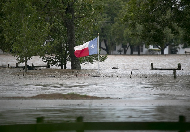 Texas flag in floodwaters caused by Hurricane Harvey