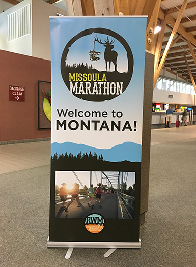 Missoula Marathon welcome sign in Missoula airport