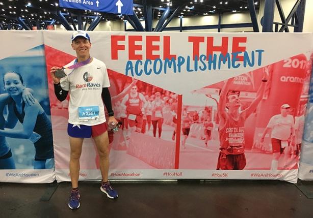 Mike feeling the accomplishment after finishing the Houston Marathon