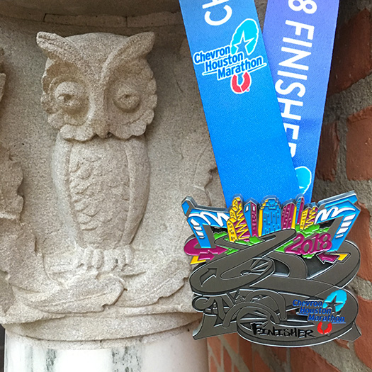 Houston Marathon medal with Rice University owl