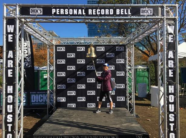 Katie ringing PR bell for Houston Marathon 5K