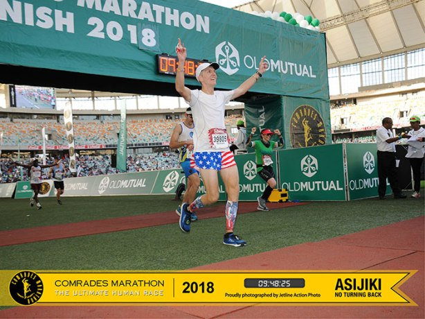 Mike Sohaskey crossing finish line of 2018 Comrades Marathon down run