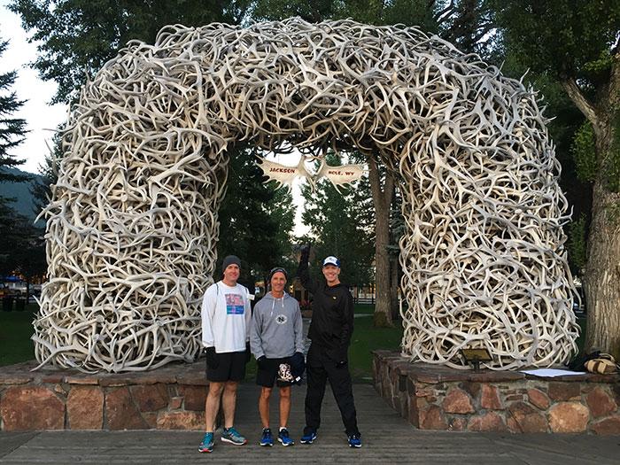 Ken S, Jeff R and Mike Sohaskey under Jackson WY elk antler arch