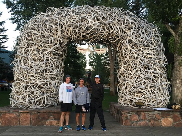 Ken S, Jeff R and Mike Sohaskey under Jackson WY elk antler arch