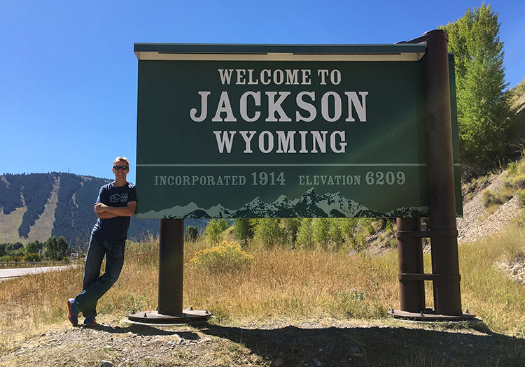 Mike Sohaskey by Welcome to Jackson WY sign