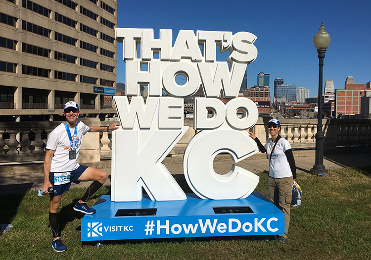 Mike Sohaskey & Katie Ho by That's How We Do KC sign