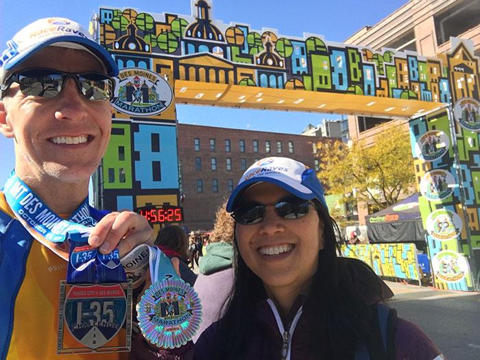 Mike Sohaskey and Katie Ho Des Moines Marathon finish line selfie
