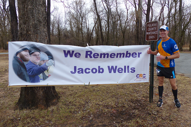Mike Sohaskey paying his respects to Jacob Wells, founder of 3 Bridges Marathon