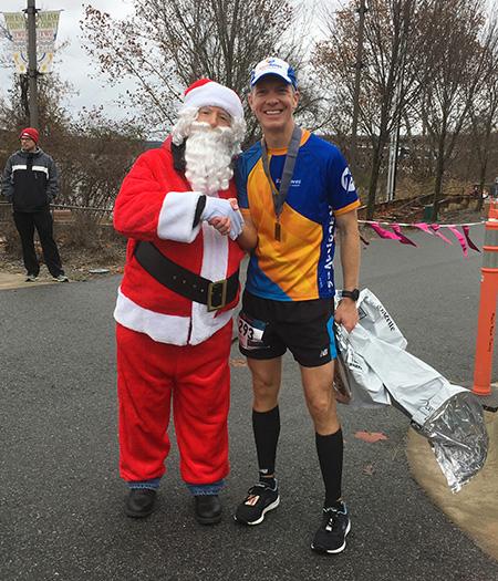 Mike Sohaskey & Santa Claus at the 3 Bridges Marathon finish