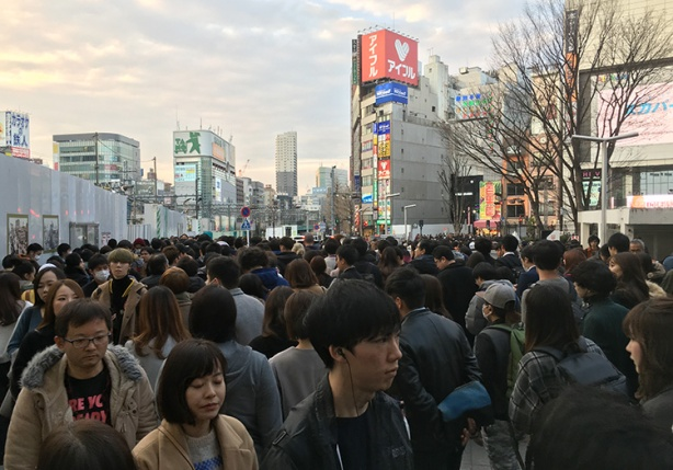 Crowds outside Shinjuku station in Tokyo