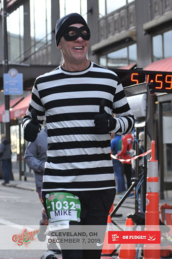 Mike Sohaskey finishing A Christmas Story 10K Run
