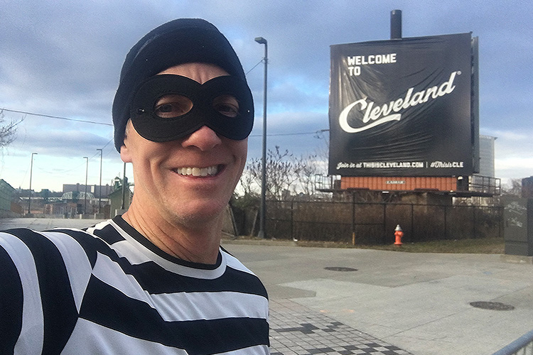 Mike Sohaskey in front of Welcome to Cleveland sign