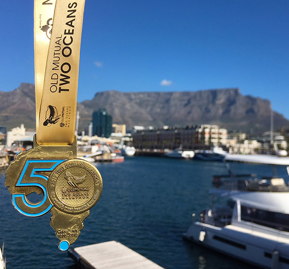 Two Oceans Marathon medal with Table Mountain backdrop