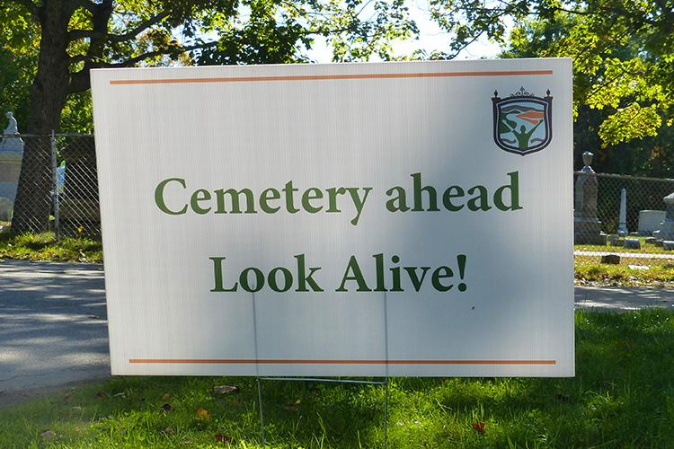 "Greenlawn Cemetery ""look alive!"" sign at Clarence DeMar Marathon"