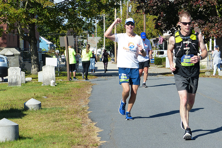 Mike Sohaskey running through Greenlawn Cemetery during Clarence DeMar Marathon