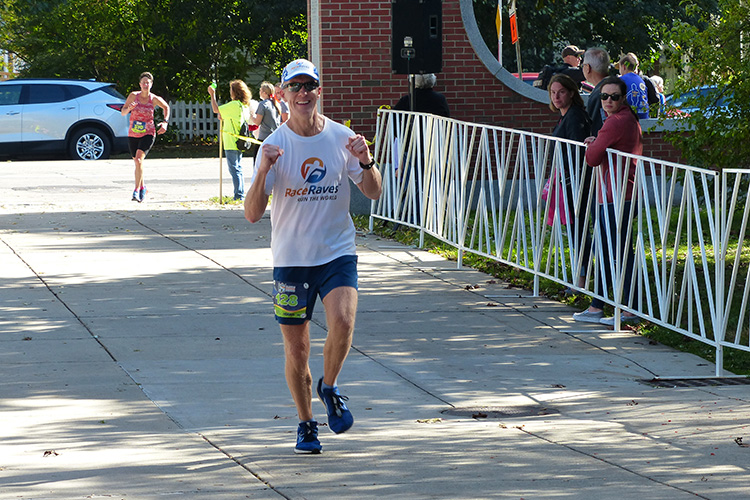 Mike Sohaskey on Appian Way during homestretch of Clarence DeMar Marathon
