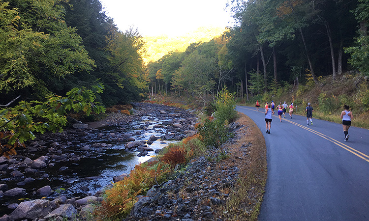 Running alongside the Ashuelot River in mile 4 of the Clarence DeMar Marathon