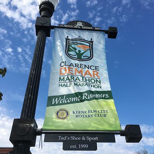 Clarence DeMar Marathon street banner in downtown Keene, NH