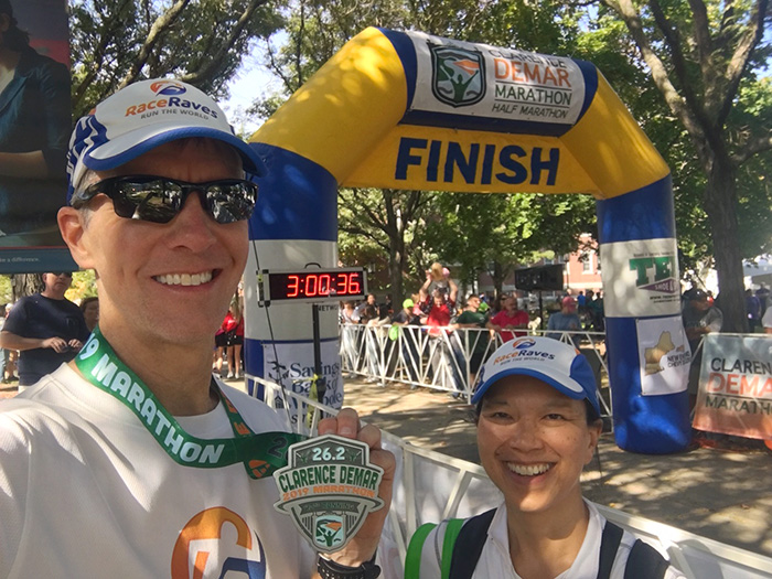 Mike Sohaskey & Katie Ho at finish line of Clarence DeMar Marathon