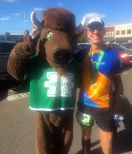 Mike Sohaskey with Marco the Bison, Marshall University's mascot