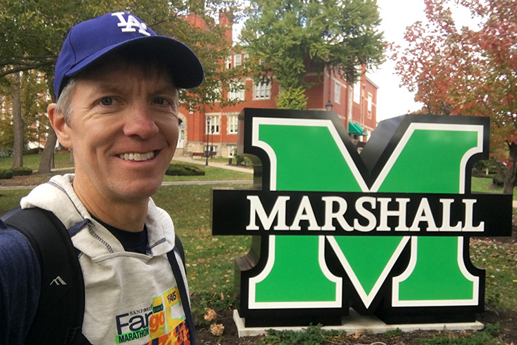 Mike Sohaskey with Marshall University sign