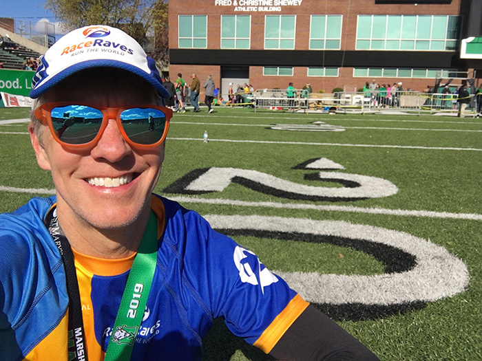 Mike Sohaskey, relaxing post-race on Marshall University's football field