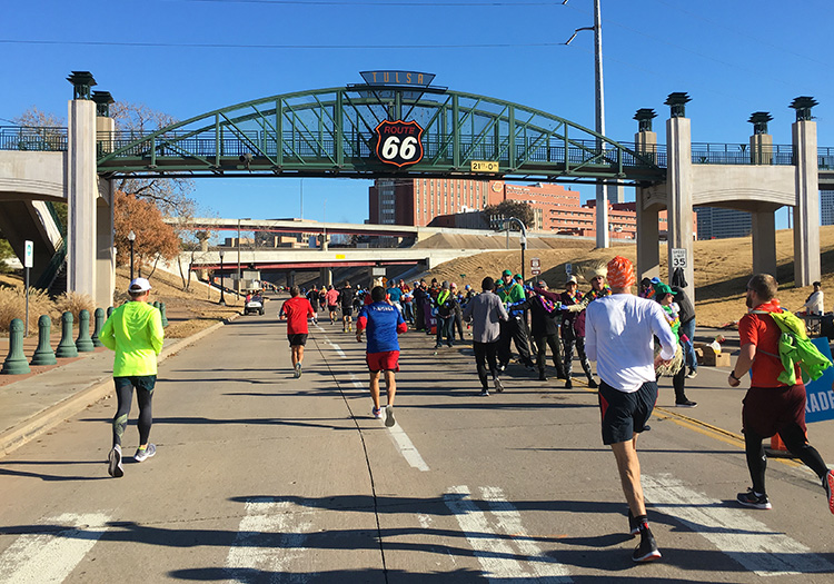 Running beneath the historic Route 66 sign during the Marathon