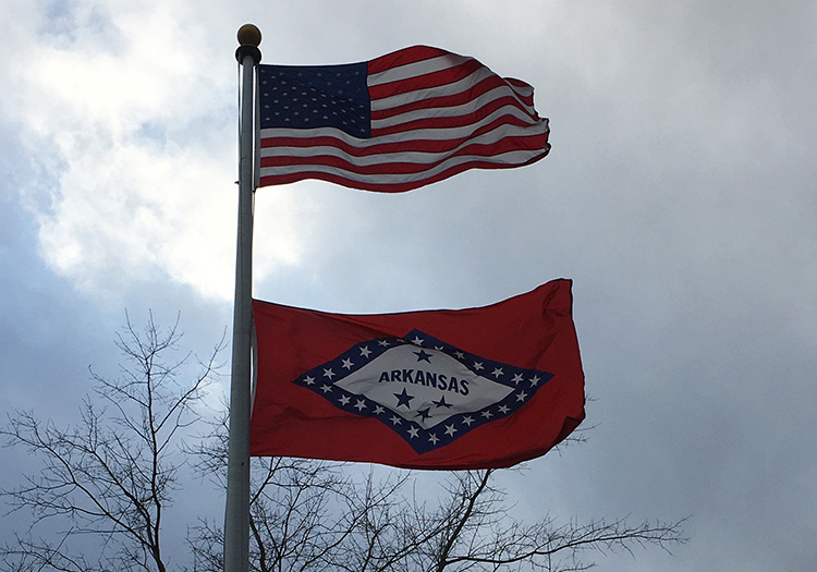U.S. and Arkansas flags