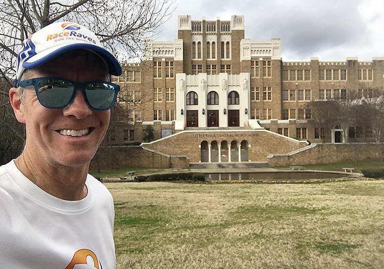 Mike Sohaskey in front of historic Central High School at mile 12 of the Little Rock Marathon